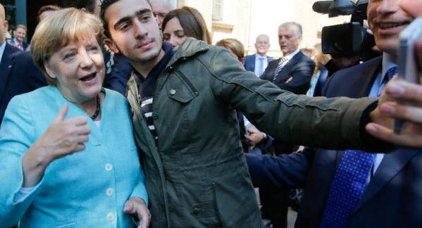 Меркель убеждает немцев полюбить мигрантов