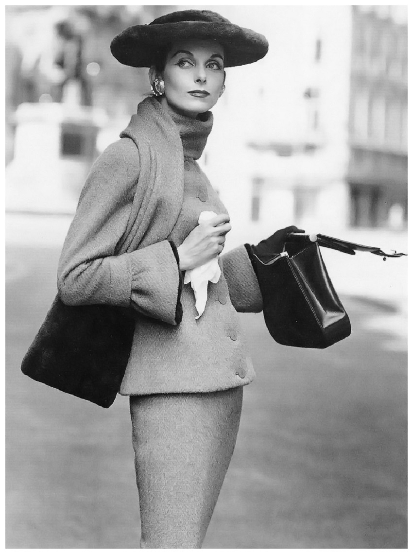 Anne St. Marie in Fath's wool suit with collar-scarf and cuffs trimmed in beaver, wide brimmed hat also beaver,Vogue, September 1955 Photo Henry Clarke.jpg