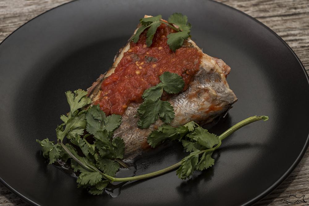 Вареный хек в томатном маринаде