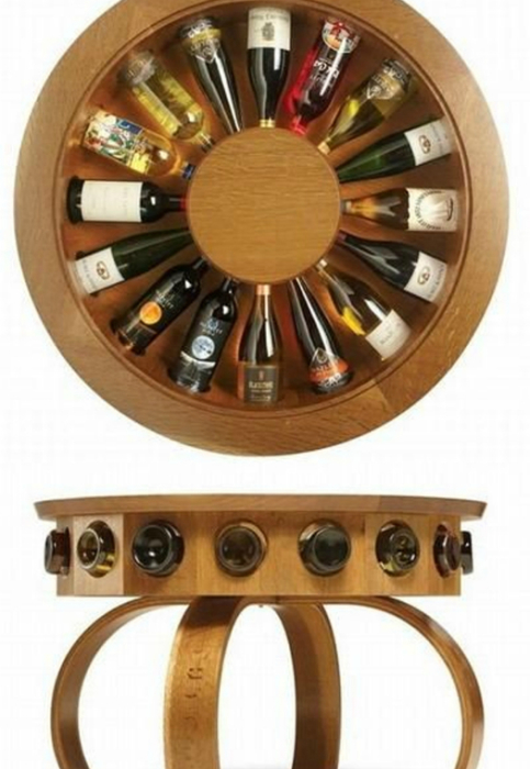 Стильный круглый стол, оборудованный под бар на 16 бутылок.