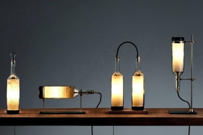 Идеи превращения винных бутылок в стильные и функциональные: Замысловатый светильник. Для создания такого светильника нужно срезать дно винной бутылки и вставить лампочку. Дизайн светильника может быть самым