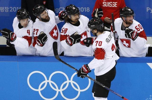 На ОИ рукопожатия хоккеистов заменили отбиванием кулачков из-за норовируса