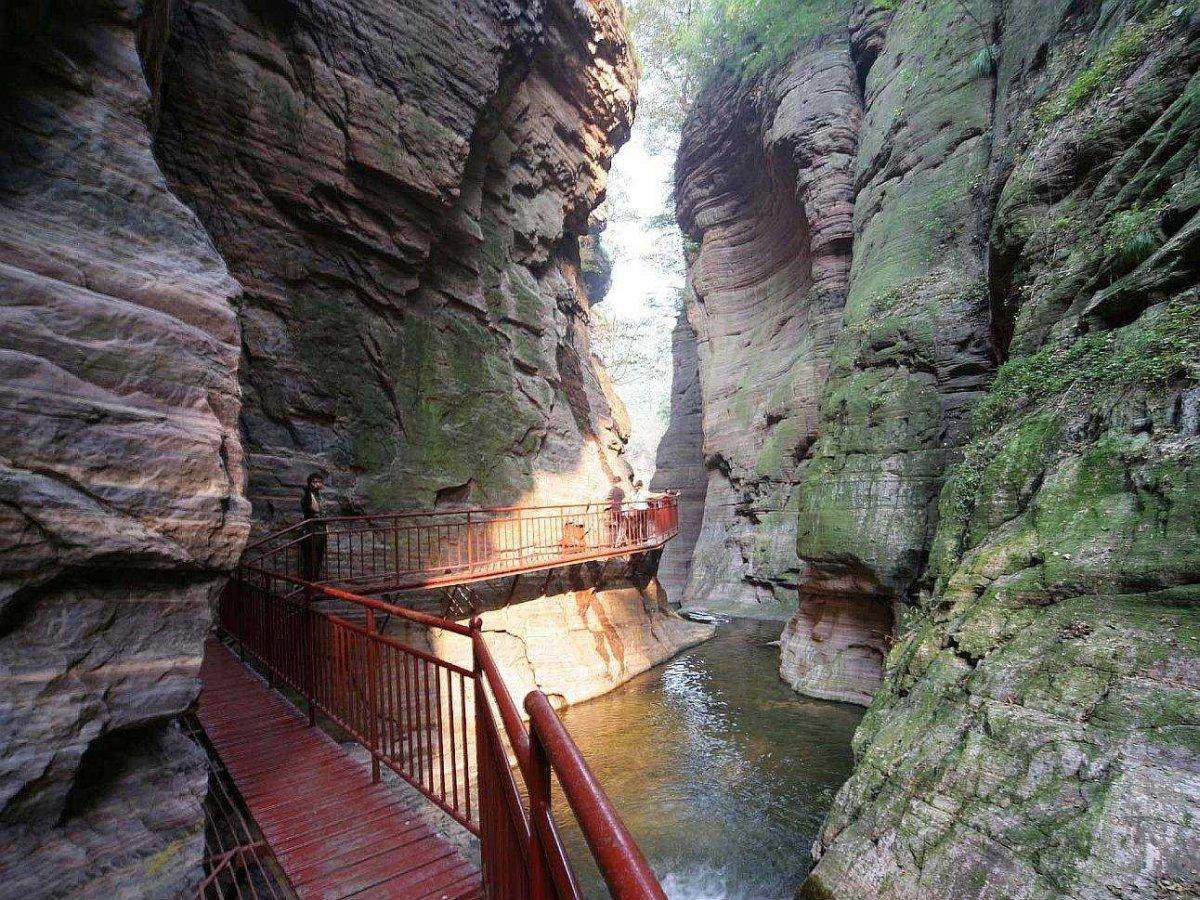venture-through-the-12-kilometer-longtan-valley-and-admire-the-reddish-purple-sandstone-quartz