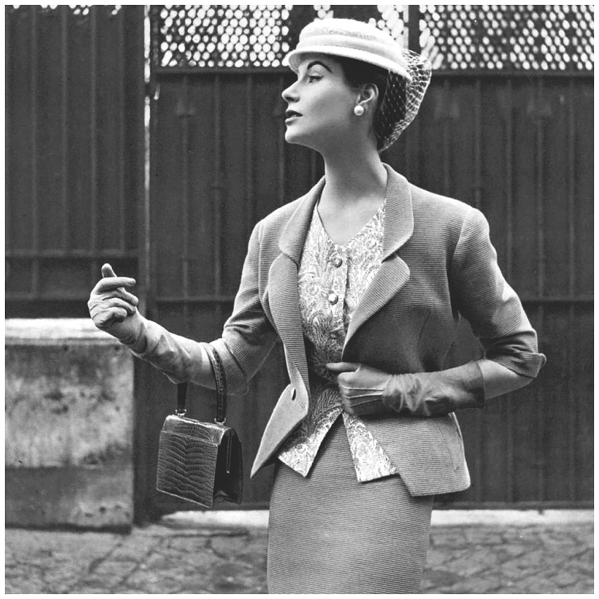 Myrtle Crawford in beige Ottoman suit with fitted jacket indented to v, worn over print cashmere top and narrow skirt by Manguin, hat by Paulette, croc bag by Morab.jpg