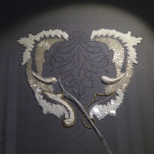 (Lesage embroidery in process, and completed.: