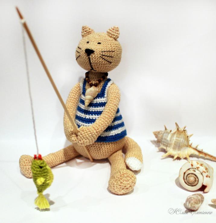 кот рыбак крючком