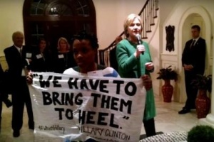 Protester confronts Clinton,…