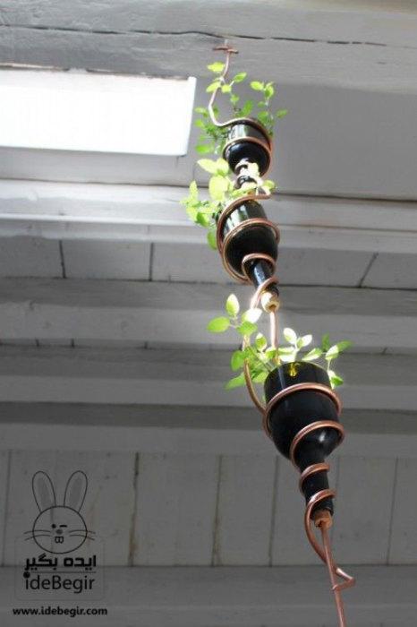 Идеи превращения винных бутылок в стильные и функциональные: Подвесной горшок. Оригинальные многоярусные цветочные горшки станут прекрасным украшением любого дома.