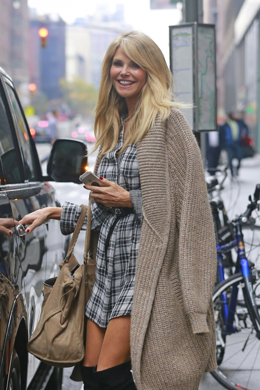 EXCLUSIVE: Christie Brinkley smiles as she gets into her vehicle on Madison Avenue in NYC