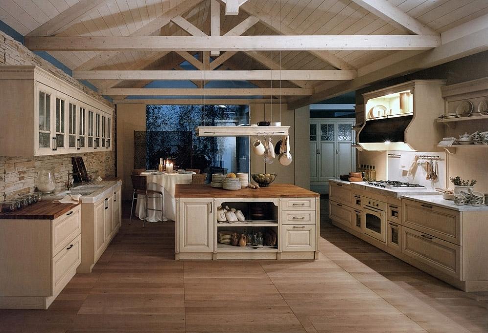 Эта кухня в стиле прованс сразу совмещена с небольшой столовой, откуда открывается замечательный вид в сад