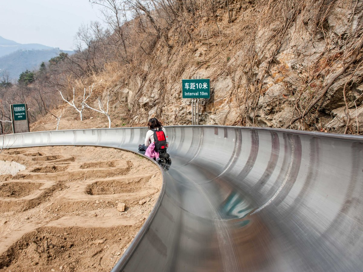 slide-down-the-great-wall-of-china-on-the-5184-foot-long-toboggan-run-which-departs-from-a-section-of-the-wall-in-mutianyu