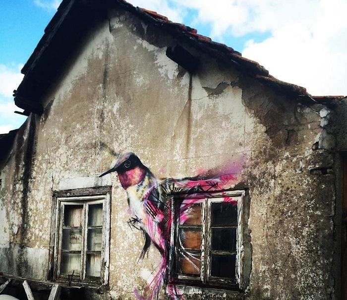 Стрит-арт от бразильского художника Luis Seven Martins или L7m в Гуарде, Португалия.