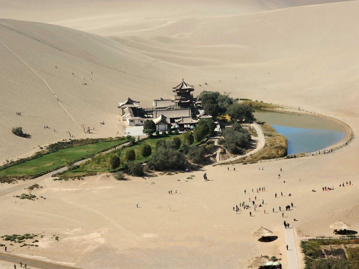 ride-a-camel-over-the-sand-dunes-of-the-gobi-desert-to-get-to-crescent-lake-in-dunhuang