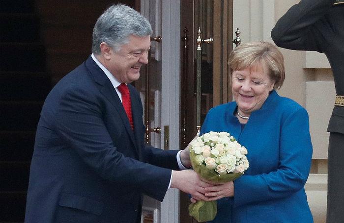 Путин встретился с представителями немецкого бизнеса, а Меркель — с Порошенко