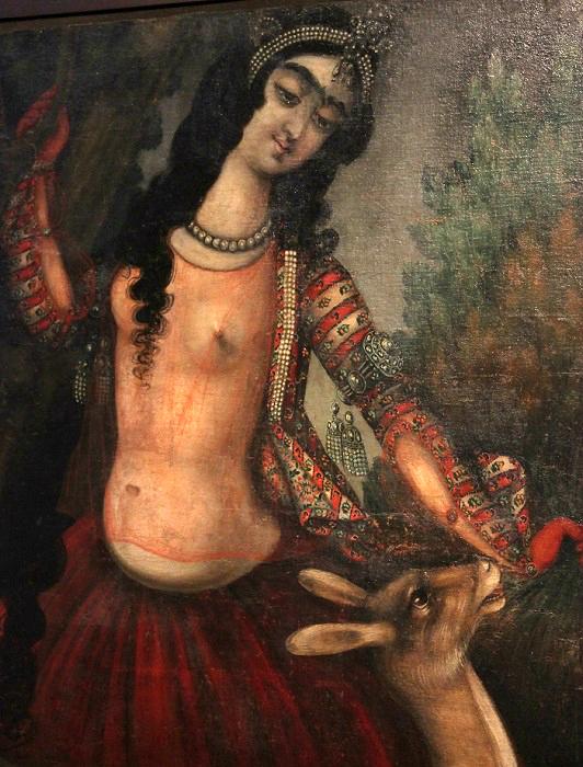 Эта красавица, играющая с ручной ланью, одета по гаремной моде. Для лучшей вентиляции рукава на её кофточке сделаны прорезными, и художник может любоваться линией её рук.