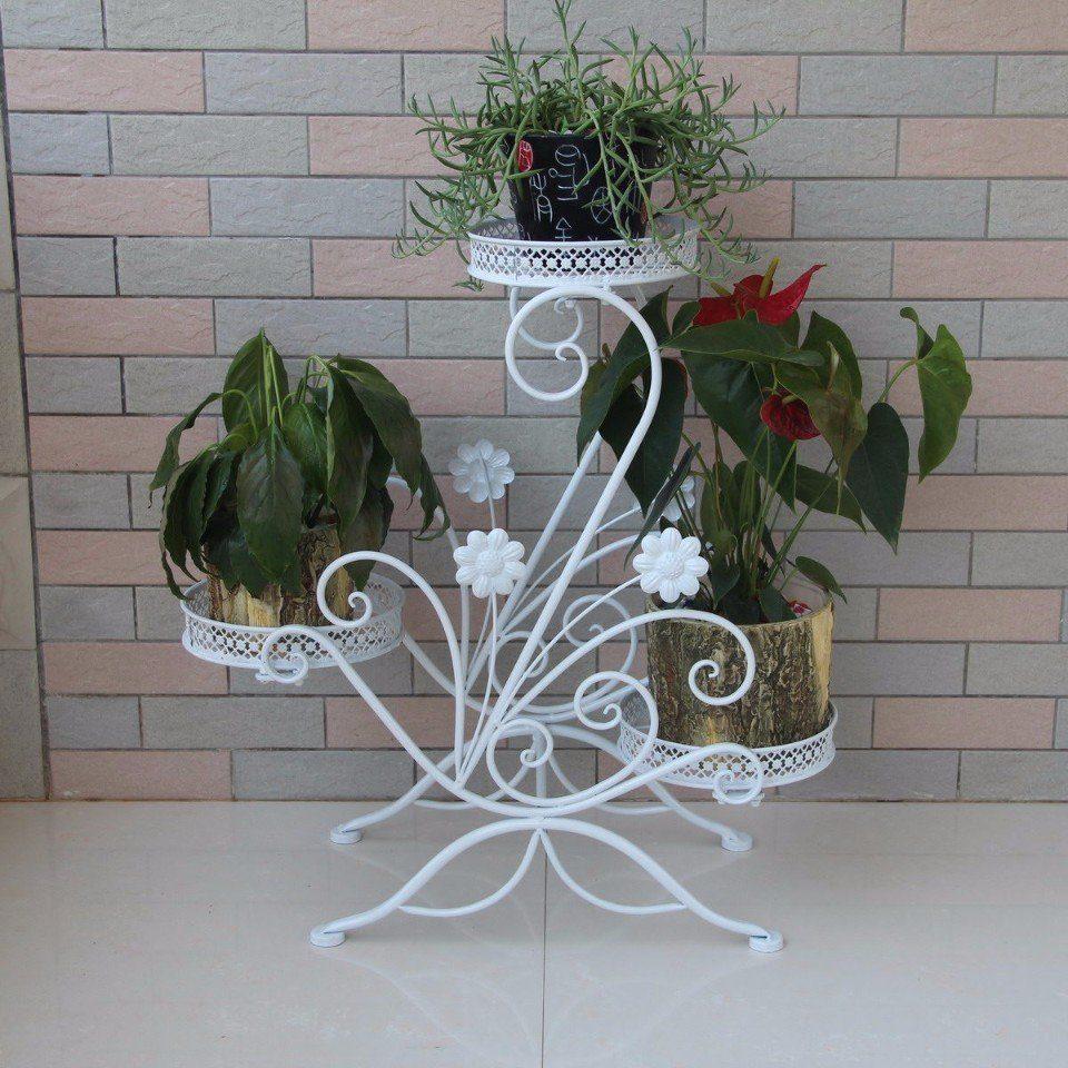 Фото подставки под цветы из метала