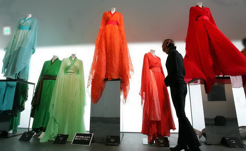 A woman looks at Japanese designer Wada's costumes in Tokyo