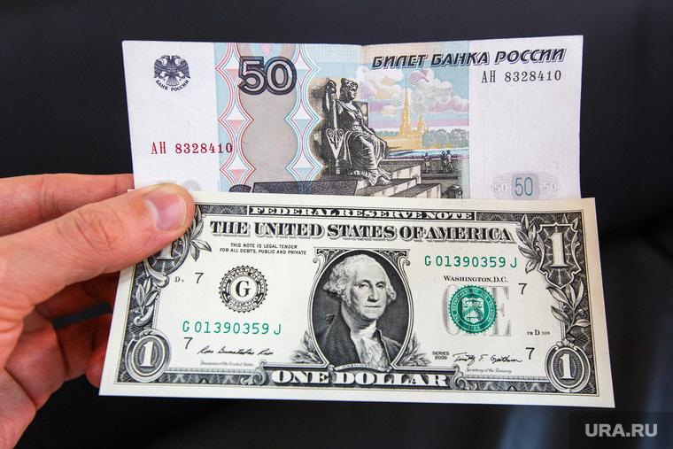 Российские миллионеры вывели больше половины своих денег за границу