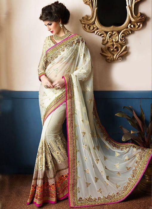 Основные украшения располагаются на окантовке вдоль верхнего и нижнего краев ткани и на паллу – это край полотна, который свисает с плеча женщины или накидывается на голову