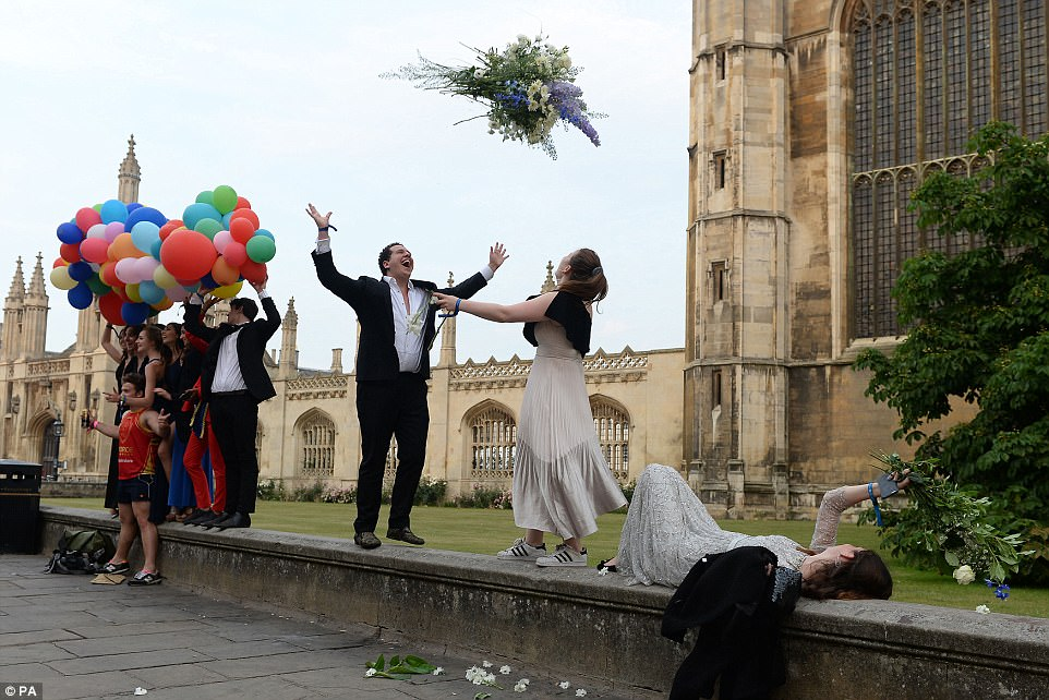 Students toss extravagant bouquets into the air as they let their hair down following a night of heavy drinking and dancing