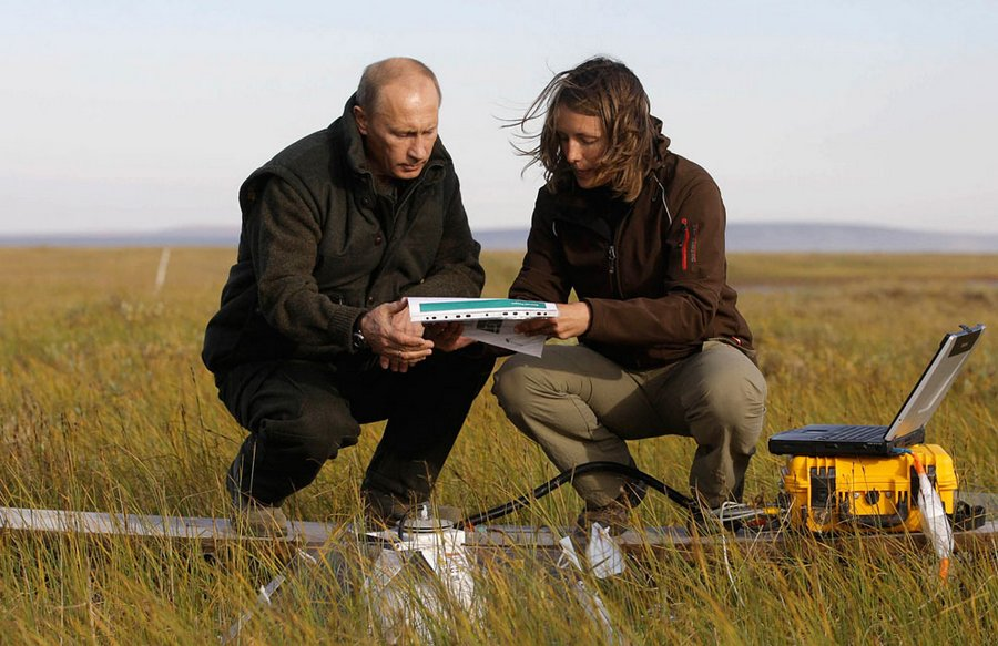 "Vladimir Putin speaks with a member of the Russian-German expedition ""Lena-2010"" on the island Samoilovsky in the Far East, 23 August 2010.  On Monday, Putin visited the Arctic Circle and saw evidence of changes in climate after the record high temperatures in the summer of 2010."