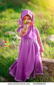 stock-photo-little-muslim-girl-with-wildflowers-masha-and-the-bear-style-1039988491.jpg