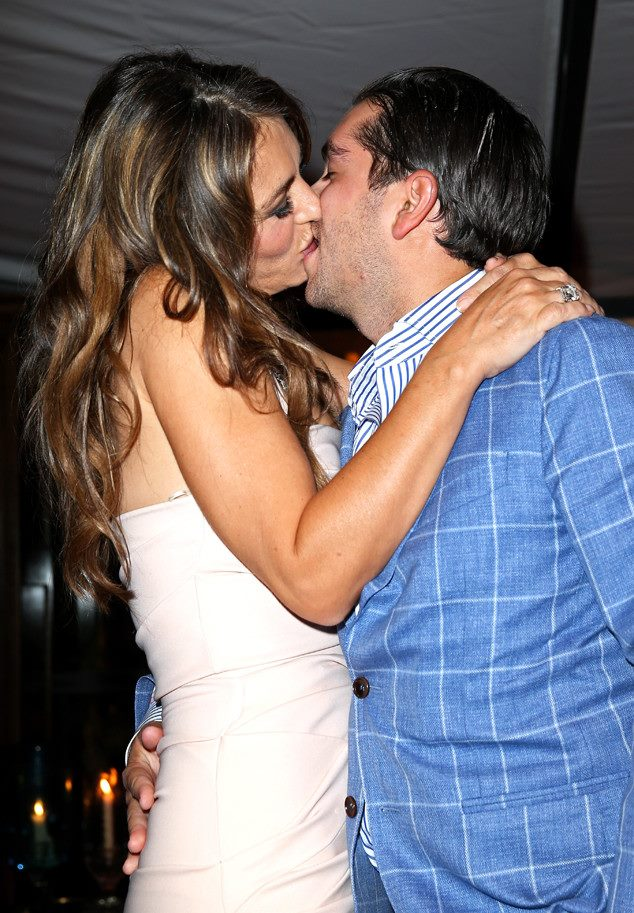 London: A man has paid 50,000 pounds to kiss actress Elizabeth Hurley at singer Elton John's charity auction.  <div id=
