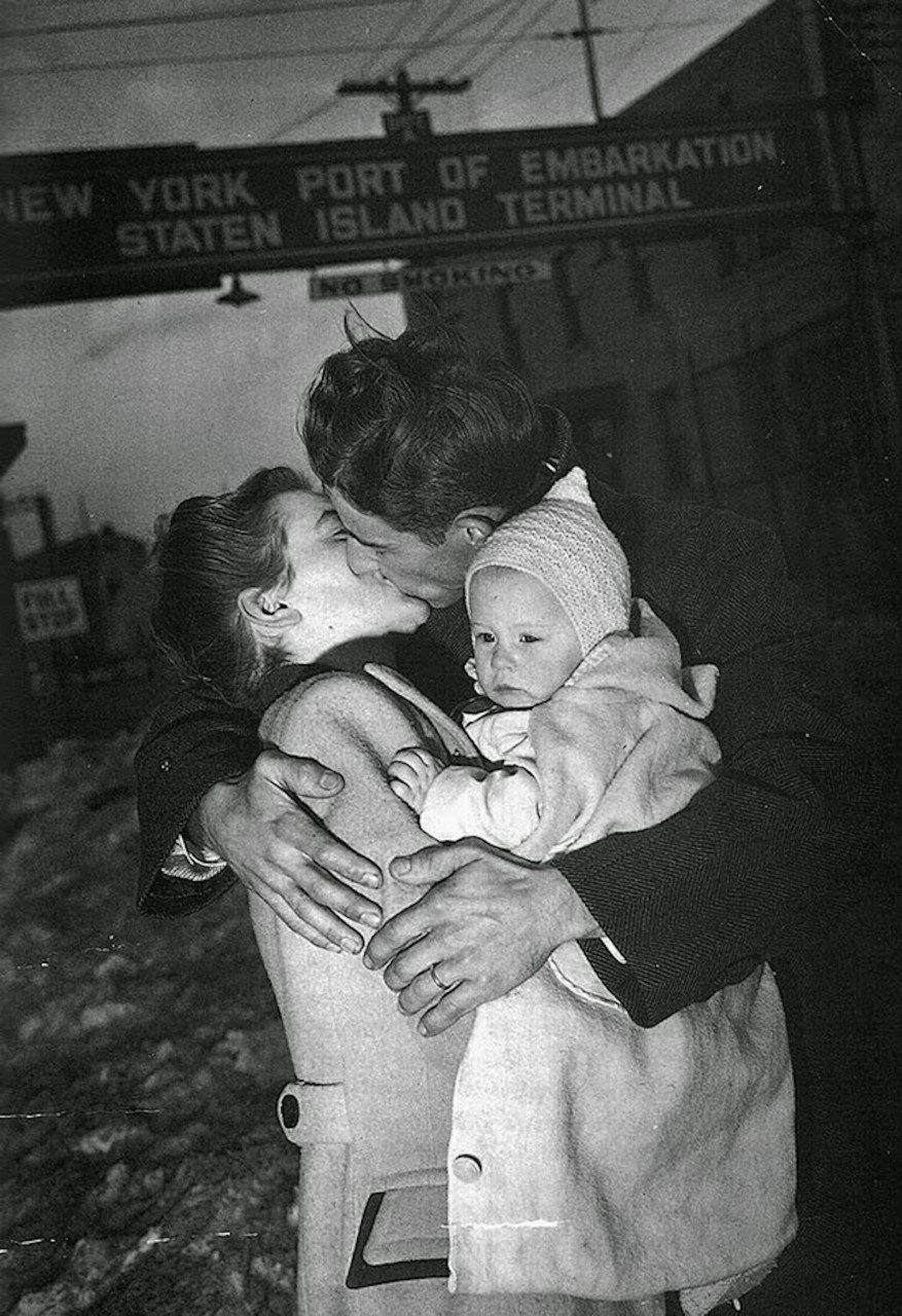 A soldier is welcomed home by his wife and baby, 1940s