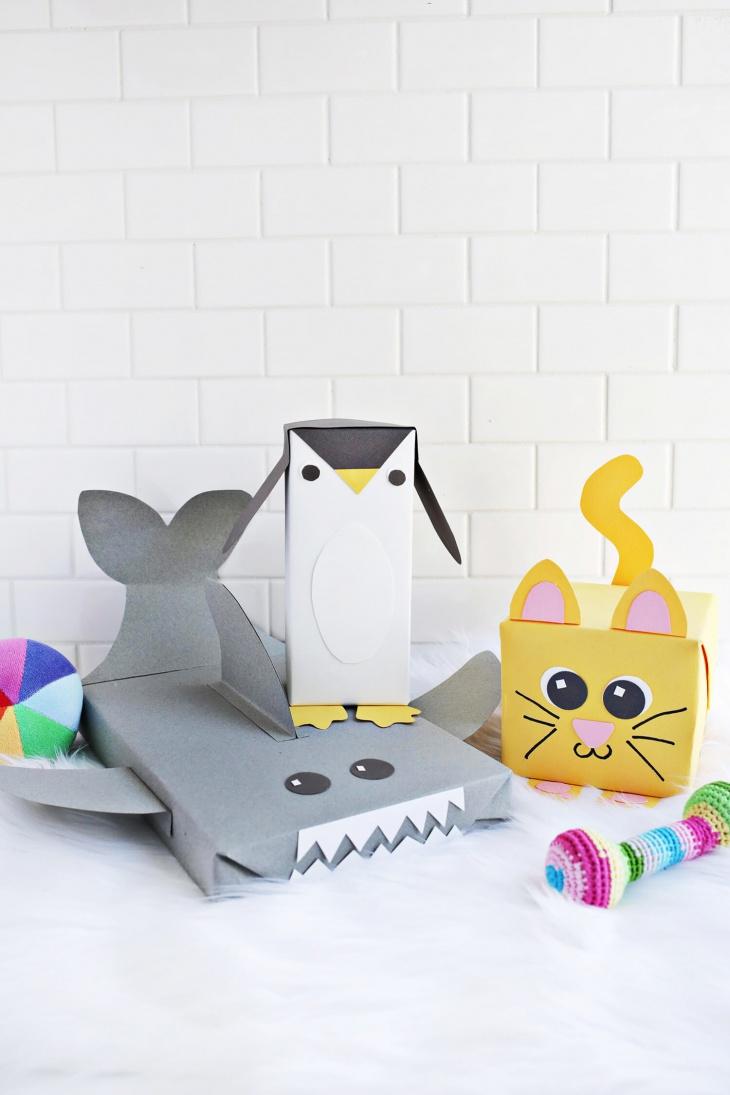 Упаковка подарка в виде пингвина и Ко