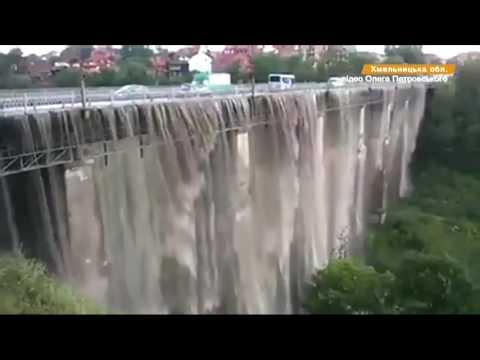 В Украине ливень превратил мост в водопад