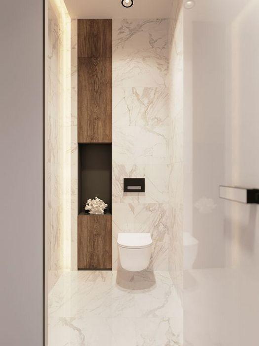 Встроенная система хранения в маленьком туалете.