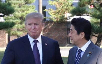 Азиатское турне Трампа началось с партии в гольф с японским премьером