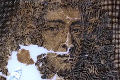 Показан процесс реставрации карты мира XVII века