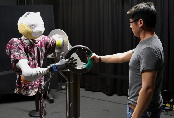 This robotic arm slows down to avoid the uncanny valley