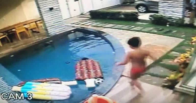 Камера наблюдения засняла, как 7-летний мальчик спасает младшего брата от утопления. Посмотрите на этого маленького героя!