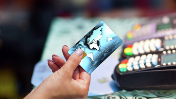 Греф: клиенты Сбербанка скоро избавятся от пластиковых карт Original