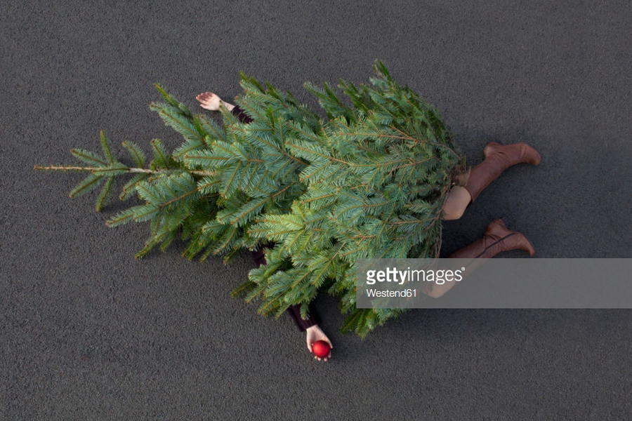 Woman lying Christmas tree