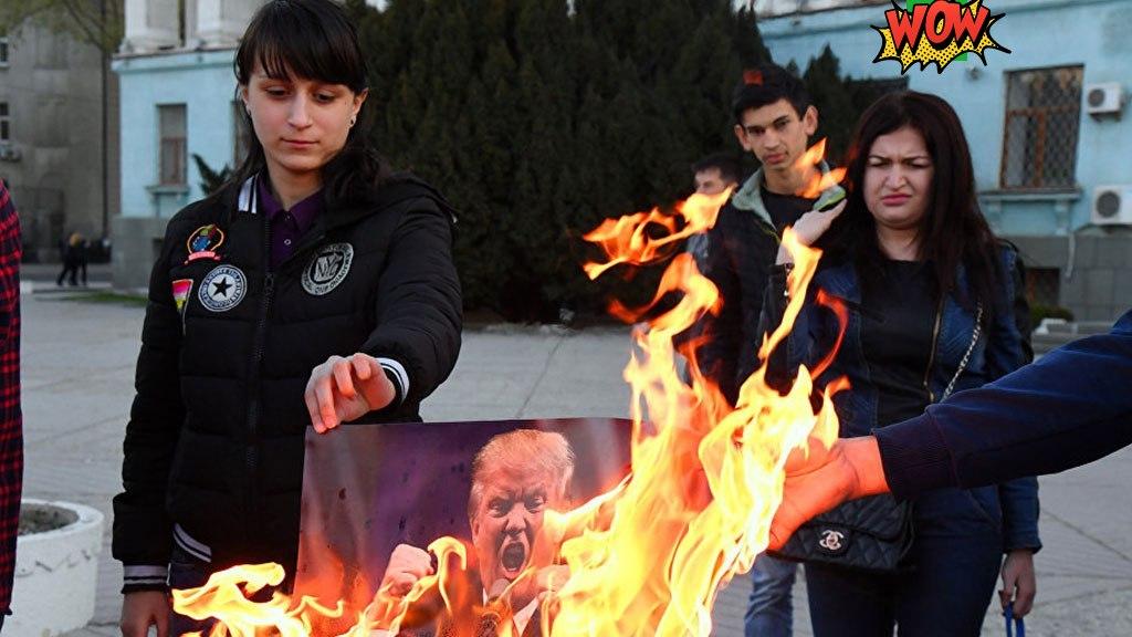Симферопольцы сожгли портреты Трампа, Макрона и Мэй