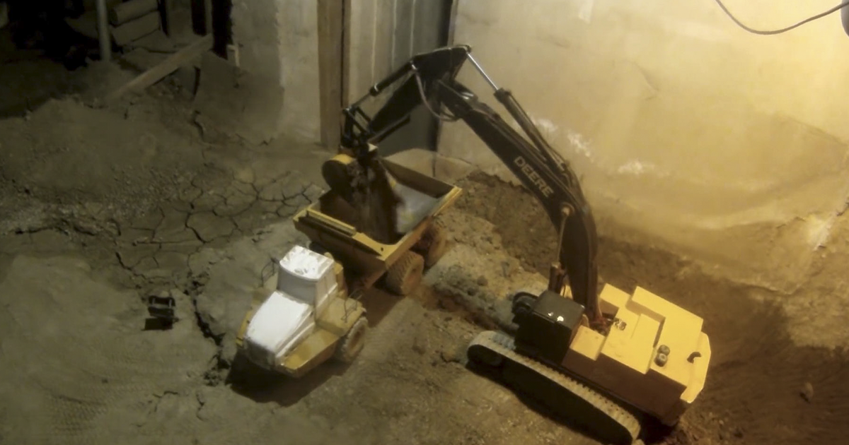 RC Toy Enthusiast Has Been Excavating His Basement With Custom-Built Mini Diggers Since 2005