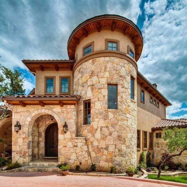 Отделка фасадов частных домов искусственным камнем - 30 фото
