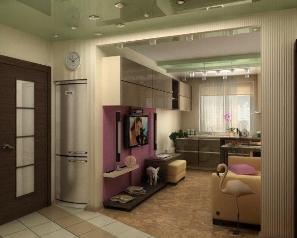 Интерьер гостиной и кухни в маленькой квартире.