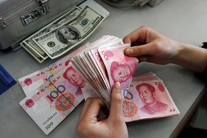 Назван срок отказа от доллара в расчетах с Китаем