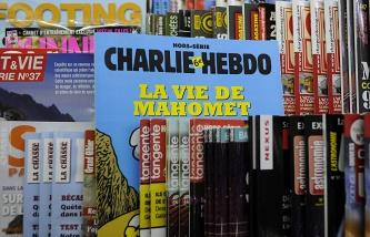 ТАСС: Французские СМИ опубликовали кадры бегства террористов с места нападения на Charlie Hebdo