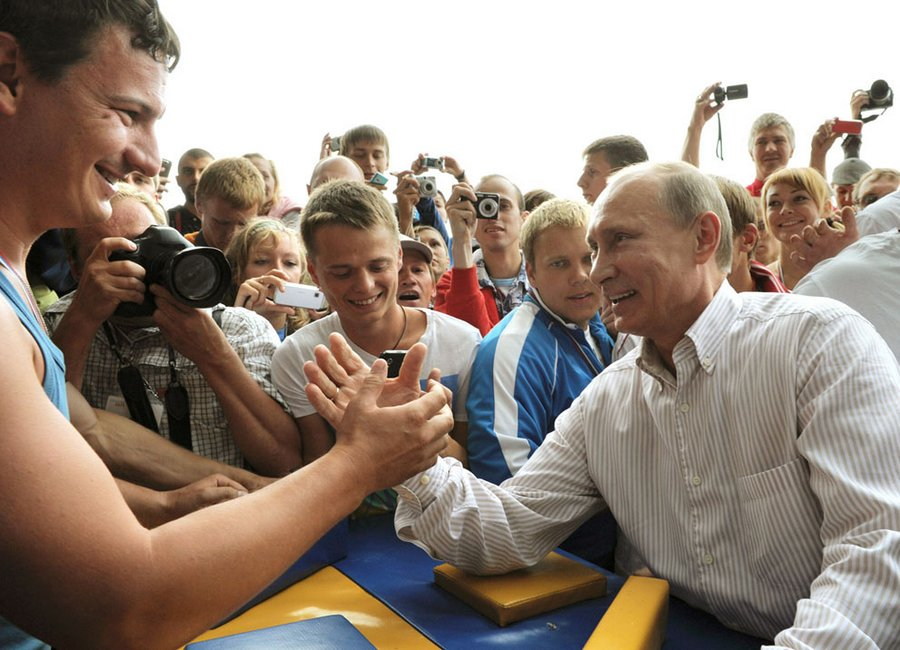 "Putin participates in competitions in weightlifting at the summer camp of the youth organization ""Nashi"" at Lake Seliger in the center of Tver Region, August 1, 2011.  The camp brought together thousands of young activists from 84 regions of Russia."