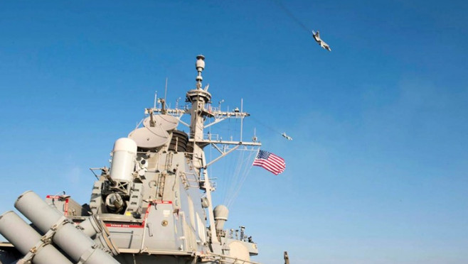 Авианосная группировка США приступила к ударам по ИГ* в Сирии