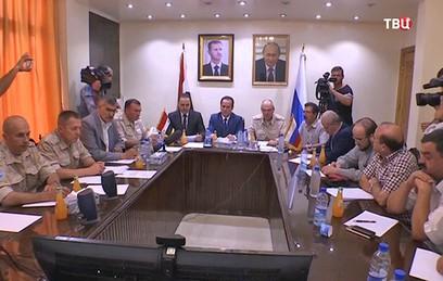 Представители властей Сирии и оппозиции провели видеоконференцию