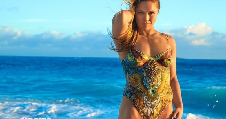 Издание Sports Illustrated опубликовало новые фотографии Ронды Роузи в нарисованном купальнике