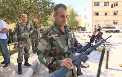 Сирийские военные показали отбитое у боевиков оружие