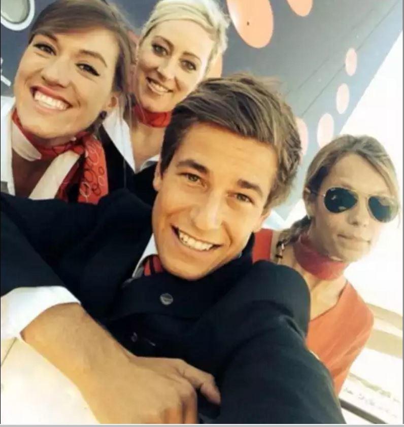 8. Экипаж из Brussels Airlines, с почти преступно миловидным мужчиной люди, пилоты, стюардессы