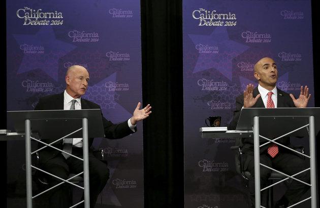 Gov. Jerry Brown, left, and Republican challenger Neel Kashkari both speak during a gubernatorial debate in Sacramento, Calif., Thursday, Sept. 4, 2014. (Rich Pedroncelli/AP Photo/Pool)